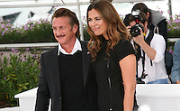 Sean Penn and Roberta Armani at the HAÏTI CARNAVAL IN CANNES photocall at the 65th Cannes Film Festival. Friday 18th May 2012 in Cannes Film Festival, France.