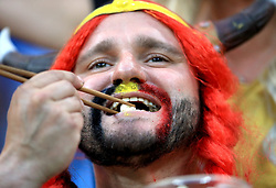 A Belgium fan shows support for his team in the stands