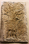 Hunting Scene wall panel. Assyrian, approximately 710-705 BC. From the royal palace in Khorsabad. An unusual scene carved in black stone, found in the private part of the palace.
