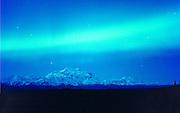 Alaska.  Mt. McKinley and Northern Lights (Aurora Borealis) swirl above America's tallest peak.