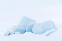 Icebergs covered with fresh snow at Fjallsárlón Glacial Lagoon, Southeast Iceland.