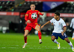SWANSEA, WALES - Thursday, November 12, 2020: Wales' Harry Wilson (L) and USA's Tyler Adams during an International Friendly match between Wales and the USA at the Liberty Stadium. (Pic by David Rawcliffe/Propaganda)