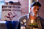 """04 JANUARY 2012 - PHOENIX, AZ:   KEN ALANDT holds a candle during a vigil for Marty Atencio in front of the Maricopa County Jail in Phoenix on January 4. Atencio died in a Phoenix hospital on Dec 20, 2011. He was arrested by Phoenix police a few days earlier after he exhibited """"bizarre"""" behavior on the street. He was booked into the Maricopa County Jail. During the booking process he was tackled by Maricopa County Detention Officers and repeatedly hit was a Taser stun gun. He was later found unconscious in a holding cell and transferred to a hospital, where he died four days later. An autopsy showed no signs of illegal drugs or intoxication and a video from the jail showed that Atencio was not violent in the jail. His family has hired a lawyer and may sue the Maricopa County Sheriff's Department, which administers the jail.    PHOTO BY JACK KURTZ"""