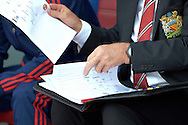 a close up view as Louis van Gaal, the Manchester United Manager looks at his notes and team sheets before the match. Barclays Premier League match, Crystal Palace v Manchester Utd at Selhurst Park in London on Saturday 31st October 2015.<br /> pic by John Patrick Fletcher, Andrew Orchard sports photography.