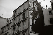 A billboard on the wall of a building in the 16th arrondissement of Paris