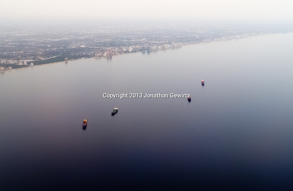 Aerial view of cargo ships at anchor in the Atlantic Ocean near Fort Lauderdale, Florida. WATERMARKS WILL NOT APPEAR ON PRINTS OR LICENSED IMAGES.