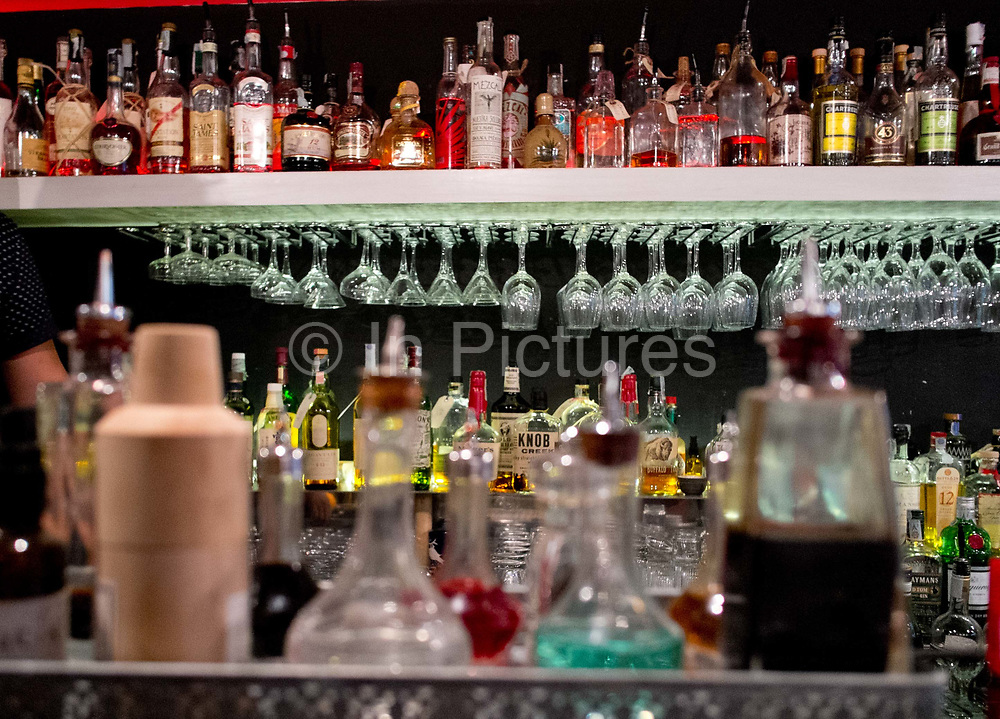 Detail shot of bottles in a Cocktail bar: Barnum / cocktail tours. Rome, Italy.