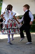 Young Svab children in traditional dress dancing at the wine harvest festival , Hajos (Hajós) Hungary .<br /> <br /> Visit our HUNGARY HISTORIC PLACES PHOTO COLLECTIONS for more photos to download or buy as wall art prints https://funkystock.photoshelter.com/gallery-collection/Pictures-Images-of-Hungary-Photos-of-Hungarian-Historic-Landmark-Sites/C0000Te8AnPgxjRg