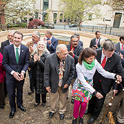 Virginia Governor, Ralph Northam, performs the ceremonial ribbon cutting, during the dedication ceremony for Mantle: Virginia Indian Tribute, a monument designed on Virginia State Capitol Square, in Richmond, Virginia, on Tuesday, April 17, 2018.  John Boal Photography