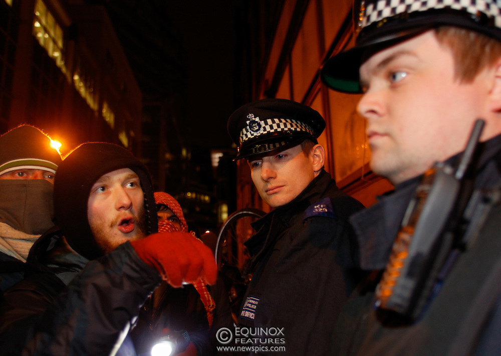 London, United Kingdom - 30 January 2012.Police and bailiffs clash with Occupy London protesters and their supporters as they evict them from the Occupy Bank of Ideas site. The campaigners had formed a self styled Earl Street Community Space in part of a building owned by UBS Bank, Earl Street, City of London, London, England, UK..Copyright: ©2012 Equinox Licensing Ltd. +448700 780000 - Contact: Equinox Features - Date Taken: 20120130 - Time Taken: 014828+0000 - www.newspics.com