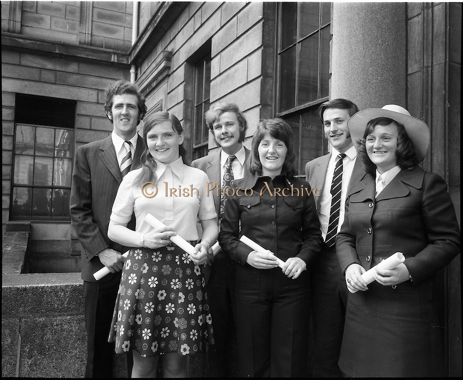 """07/06/1973.06/07/1973.07 June 1973.The president of the Incorporated Law Society,Mr. T. V. O'Connor presented parchments to young solicitors at the Four Courts, Dublin on Thursday. Picture shows (l-r): Mr Robert P. Barrett, B.C.L., """"Moyne"""", Model Farm Road, Cork; Miss Nancy O'Driscoll, B.C.L., Kilcrea, Ovens, Co. Cork; Mr. George D.R. Mills, B.C.L., Belvedere Lawn, Douglas Road, Cork; Miss Paula Desmond, B.C.L., Kilbeg, Bandon, Co. Cork; Mr. declan C. Carroll, B.C.L., """"Linden"""", Fermoy, Co. Cork and Miss Goretti Hickey, B.C.L., """"Shalimar"""", Hettyfield, Douglas, Co. Cork after they had received their parchments at the formal addmission of solicitors into their profession."""