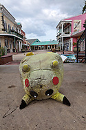 Moldy stuffed animal in front of abandoned building at Six Flags in New Orleans. <br /> Six Flags New Orleans amusement park in Eastern New Orleans, Louisiana, closed since Hurricane Katrina  in 2005 remains in a sate of ruin. The remains of Six Flags amusement park are on low lying land owned by the city of New Orleans and have not be redeveloped since Katrina.