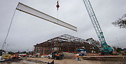 The final beam is put in place during construction at Young Women's College Preparatory Academy, January 25, 2017.