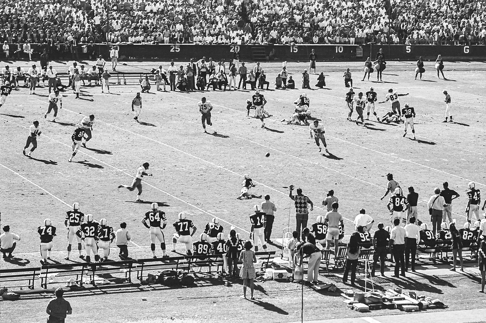 COLLEGE FOOTBALL:  Stanford vs USC (#4 ranking) on October 10, 1970 at Stanford Stadium in Palo Alto, California.  Stanford won by a final score of 24-14.  Visible players include Jim Plunkett #16, Randy Vataha #18.  Photograph by David Madison / www.davidmadison.com.  R0067
