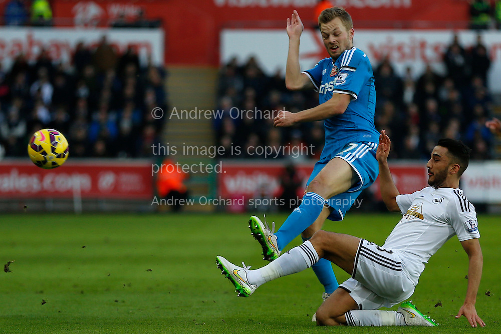Neil Taylor of Swansea (right) tackles Sebastian Larsson of Sunderland.<br /> Barclays Premier League match, Swansea City v Sunderland at the Liberty stadium in Swansea, South Wales on Saturday 7th Feb 2015.<br /> pic by Mark Hawkins, Andrew Orchard sports photography.