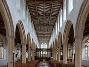 Interior view down nave to chancel with wooden roof, Holy Trinity church, Blythburgh, Suffolk, England, UK