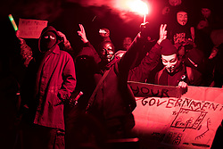 © Licensed to London News Pictures . 05/11/2016 . London , UK . Supporters of Anonymous , many wearing Guy Fawkes masks , attend the Million Mask March bonfire night demonstration , at Trafalgar Square , in central London . Photo credit : Joel Goodman/LNP