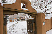 Gate to Mabel Dodge Lujan house in snow