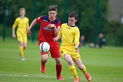 NEWPORT, WALES - Wednesday, May 27, 2015: North WPL Academy Boys' Lloydd Hughes [L] and Central WPL Academy Boys' Osian Jones (Porth) [R] during the Welsh Football Trust Cymru Cup 2015 at Dragon Park. (Pic by David Rawcliffe/Propaganda)