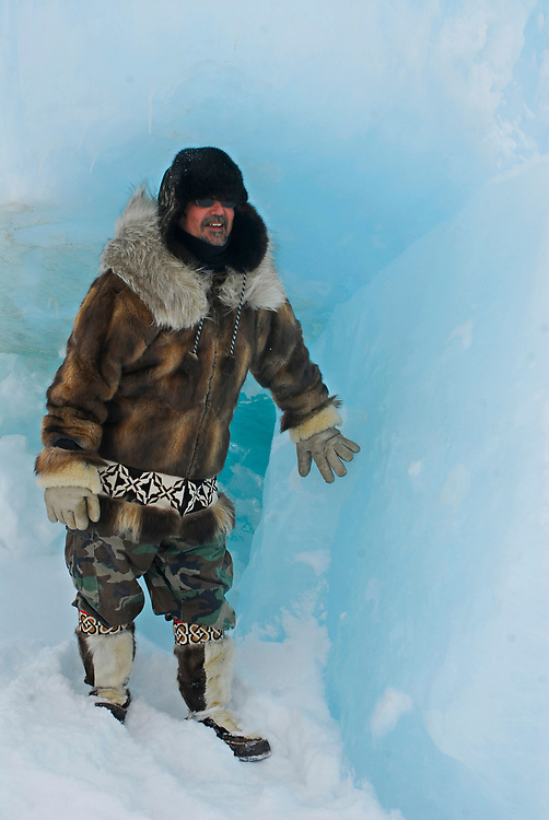 Alaska, Barrow. Whaling captain Chuck Hopson dressed in a muskrat parka and caribou mukluks. (Model Release)