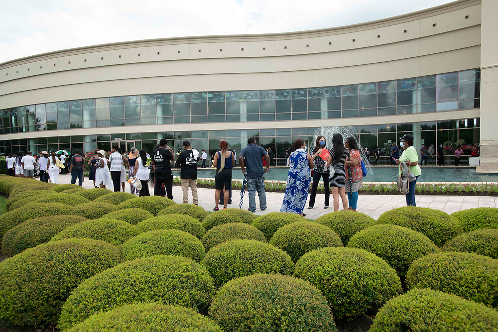 Houston, TX USA June 8, 2020: Guests prepare to file into Fountain of Praise church in southwest suburban Houston as as six-hour public visitation starts for George Floyd, killed two weeks ago in Minneapolis. A private service and burial will occur Tuesday.