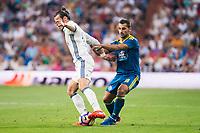 "Real Madrid's player Luka Modric and Gareth Bale and Celta de Vigo's player Jonathan Castro ""Jonny"" during a match of La Liga Santander at Santiago Bernabeu Stadium in Madrid. August 27, Spain. 2016. (ALTERPHOTOS/BorjaB.Hojas)"