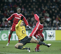 Photo: Barry Bland.<br />FC Thun v Arsenal. UEFA Champions League. 22/11/2005.<br />Robin Van Persie is fouled by Pimenta Armand .