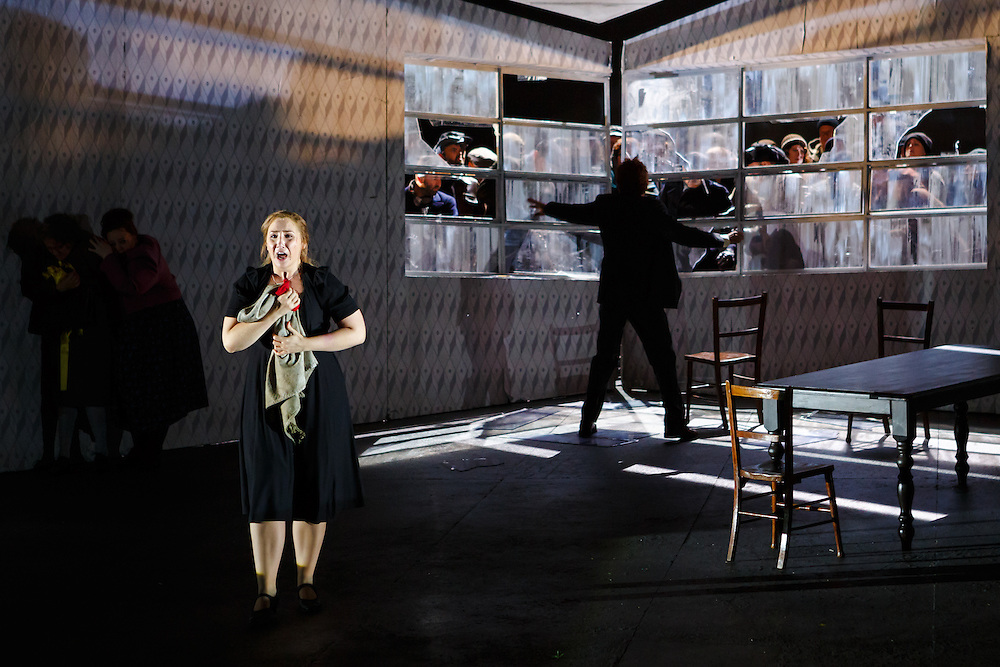 """LONDON, UK, 21 June, 2016. Laura Wilde (foreground, as Jenufa) rehearses with members of the cast for the revival of director David Alden's production of Janacek's opera """"Jenufa"""" at the London Coliseum for the English National Opera. The production opens on 23 June. Photo credit: Scott Rylander."""