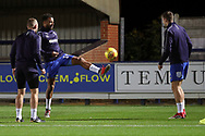AFC Wimbledon midfielder Tom Soares (19) and AFC Wimbledon defender Ben Purrington (3) warming up during the EFL Trophy group stage match between AFC Wimbledon and Stevenage at the Cherry Red Records Stadium, Kingston, England on 6 November 2018.