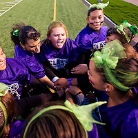 100312       Cable Hoover<br /> <br /> Miranda Wood, center, rallies the senior class defense during the Miyamura High School homecoming powderpuff football game Wednesday at Public School. Miyamura's homecoming festivities reach their finale Friday with a football game against Bloomfield.