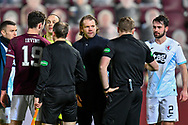 RED CARD Heart of Midlothian manager Robbie Neilson confronts Referee John Beaton after the final whistle and is shown a red card after the SPFL Championship match between Heart of Midlothian and Raith Rovers at Tynecastle Park, Edinburgh, Scotland on 23 January 2021.