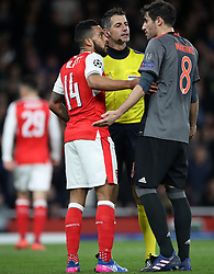 Arsenal's Theo Walcott and Bayern Munich's Aguinaga Javi Martinez (right) have words during the UEFA Champions League Round of 16, Second Leg match at the Emirates Stadium, London.
