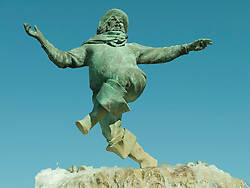 Statute of Jolly Fisherman in Skegness, based on the original painting for a Railway poster by John Hassall