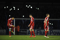 Aldershot Town's Brett Williams cuts a dejected figure as fans use their phones lights in the background  - Photo mandatory by-line: Dougie Allward/JMP - Mobile: 07966 386802 - 20/03/2015 - SPORT - Football - England - Memorial Stadium - Bristol Rovers v Aldershot - Vanarama Football Conference