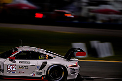 DAYTONA, FLORIDA - JANUARY 23, 2020: Porsche GT Team, Earl Bamber, Mathieu Jaminet and Laurens Vanthoor driving the Porsche 911 RSR-19 during the 58th running of the IMSA WeatherTech Sports Car Championship Rolex 24 at Daytona International Speedway.