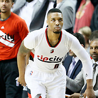 25 April 2016: Portland Trail Blazers guard Damian Lillard (0) celebrates during the Portland Trail Blazers 98-84 victory over the Los Angeles Clippers, during Game Four of the Western Conference Quarterfinals of the NBA Playoffs at the Moda Center, Portland, Oregon, USA.