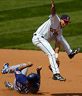 MORNING JOURNAL/DAVID RICHARD<br />Cleveland shortstop Jhonny Peralta turns a double play during the Indians' win over Texas yesterday at Jacobs Field.