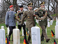 Department of Defense -- Italian and German officers lay a wreath at the grave sites of fallen Second World War Italian and German POW's at the post cemetery at Fort Riley, Kansas.