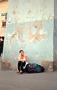 Woman age 20 waiting with luggage.  Krakow Poland