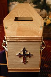 Wooden coffin lying on catafalque in a crematorium,