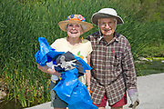 Elderly couple help clean up the Glendale narrows. FoLAR' (Friends of the LA River) annual river cleanup, La Gran Limpieza, was held  May 9, 2009. Thousands of volunteers at 14 sites pulled out accumlated trash, mostly plastic bags, from river runoff that might normally find it's way downstream into the Pacific Ocean.