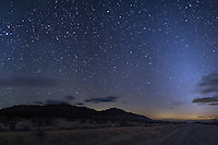 In the desert within Mojave National Preserve you can find some of the darkest skies in Southern California. It was dark enough to see the zodiacal light, which was visible 2 hours after sunset in the west. The light is made up of dust particles within our solar system illuminated by the sun. Beneath the ghostly light you can see evidence of light pollution from cities to the west.<br /> <br /> Date Taken: 1/30/14