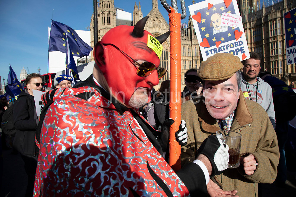 Anti Brexit pro Europe demonstrator dressed as the devil with Nigel Farage at the protest in Westminster opposite Parliament as MPs debate and vote on amendments to the withdrawal agreement plans on 14th February 2019 in London, England, United Kingdom.