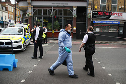 © Licensed to London News Pictures. 12/06/2020. London, UK. Police and forensic officers on Stoke Newington High Street in Hackney, North London after a Jewish man in his 50s was stabbed multiple times this morning. Police have arrested a man in his 40s on suspicion of attempted murder and are not treating the incident as terror-related. Photo credit: Dinendra Haria/LNP