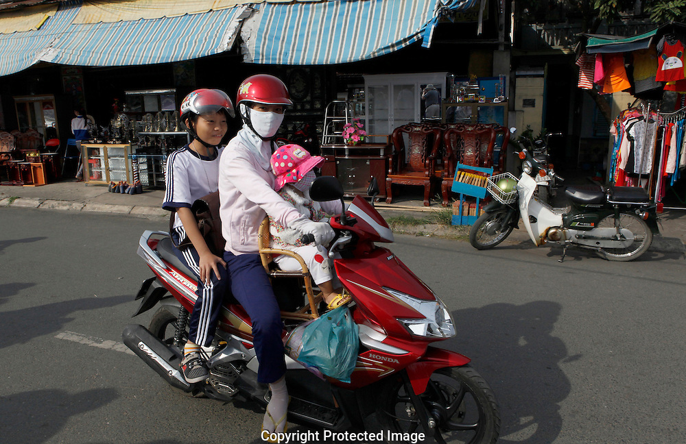 A street scene on Sa Dec  city  the Mekong River in Vietnam<br /> <br />  photo by Dennis Brack