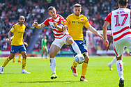 Tommy Rowe of Doncaster Rovers (10) and Ben Purrington of Charlton Athletic (16) during the EFL Sky Bet League 1 play off first leg match between Doncaster Rovers and Charlton Athletic at the Keepmoat Stadium, Doncaster, England on 12 May 2019.