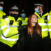 Hundreds of people gathered at a peaceful vigil for Sarah Everard on Clapham Common in South London on the 13th of March 2021, London, United Kingdom. Sarah Everard went missing on 3 March after setting off at 9pm from a friend's house to make her two-and-a-half-mile journey home and was days later found murdered. Police making arrests. People had turned out to pay respect and love and mourn Sarah Everard as well as all the women and girls who on a daily basis are hurt by men. It was an event full of sadness and reflection and anger but peaceful. The vigil was not sanctioned by police because of Covid restrictions and the police decided to arrest a number of people in an attempt to break up the peaceful and highly emotional vigil. The event took place around the band stand on the common and speeches were held from the stand till police confiscated the sound equipment. The police have since been highly criticized for their handling of the event.