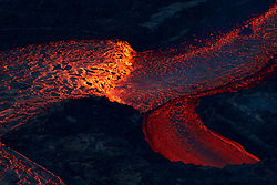 July 5, 2018 - Hawaii, U.S. - Near the Kapoho Crater, in the area called Four Corners, the lava channel makes a 90-degree bend. After lava exits the bend, it makes a short drop to form a lavafall. A side channel makes a short surface diversion before rejoining the existing channel. (Credit Image: ? USGS/ZUMA Wire/ZUMAPRESS.com)