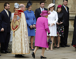 Members of the Royal family watch as the Dean of Windsor David Conner walks with Queen Elizabeth II as she arrives for the Easter Mattins Service at St George's Chapel, Windsor Castle, Windsor.