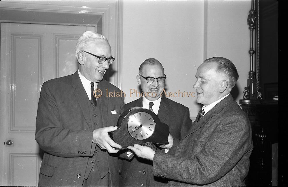 22/06/1965<br /> 06/22/1965<br /> 22 June 1965<br /> Presentation to Mr. Montague at the Shelbourne Hotel, Dublin. At a private dinner in the Shelbourne Hotel, a group of Dublin Businessmen made a presentation to Mr. F.J. Montague, retiring Manager of the O'Connell Street Branch of the Northern Bank Ltd. Picture shows Mr. W. Davidson, (left) Director, Northern Bank Ltd. (Belfast) handling over the gift to Mr. F.J. Montague. Centre is Mr. James Plant, newly appointed Manager of the O'Connell Street Branch.